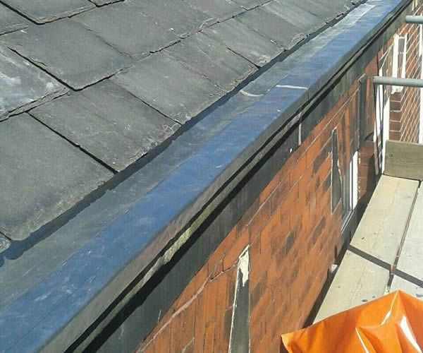 roofing work - stone guttering repairs after